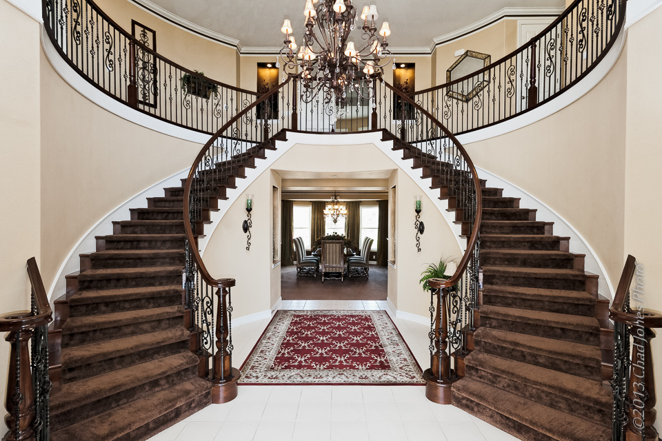 Double staircase in a moorpark country club estates home for Dual staircase house plans